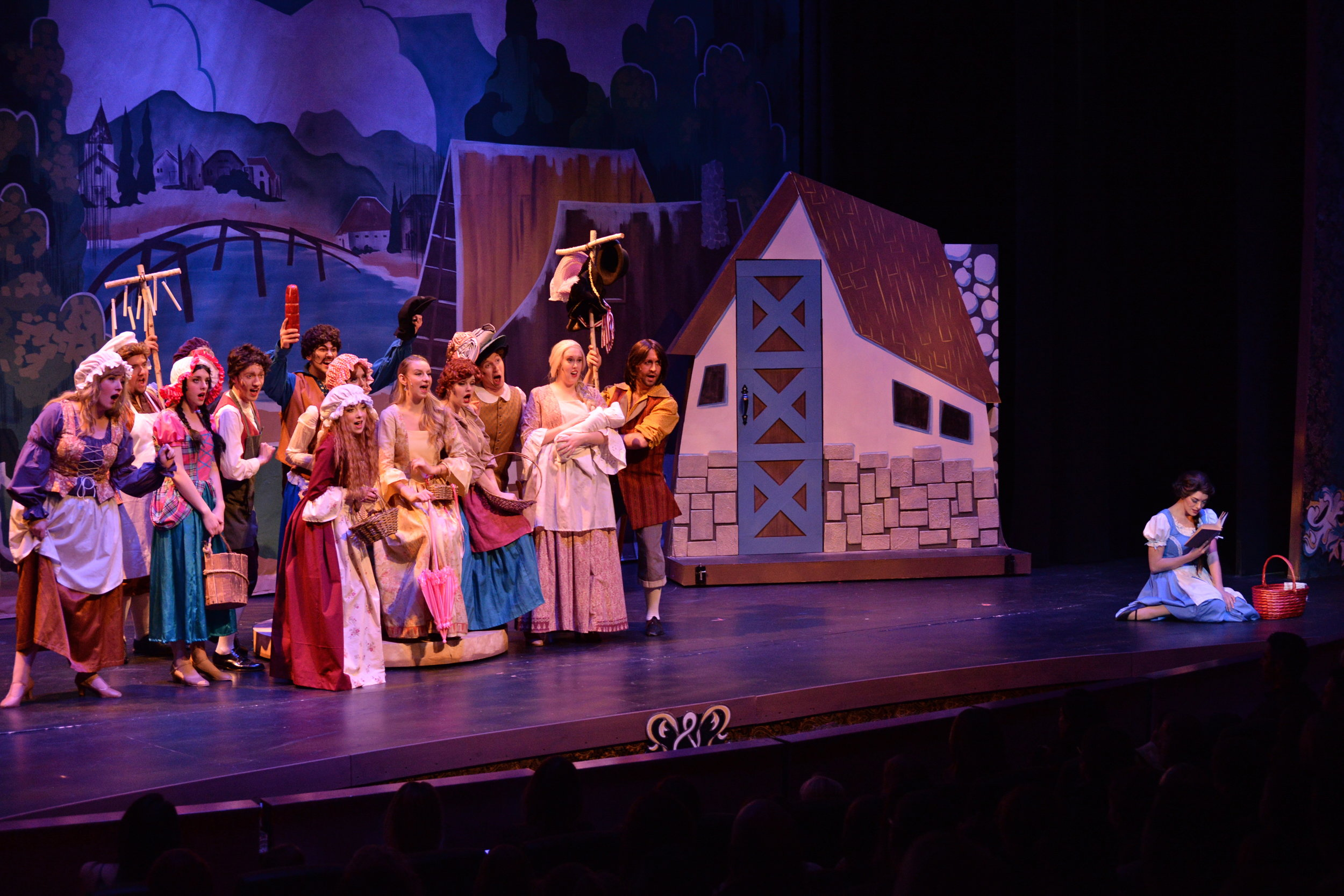 "Belle reads as the townsfolk marvel in confusion during ""Belle""."