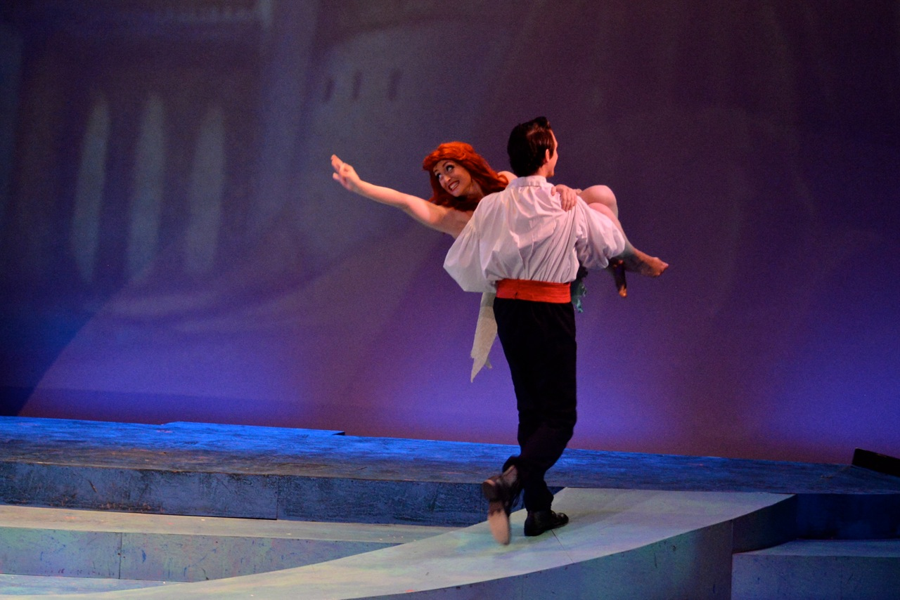 Prince Eric carries Ariel away to the castle