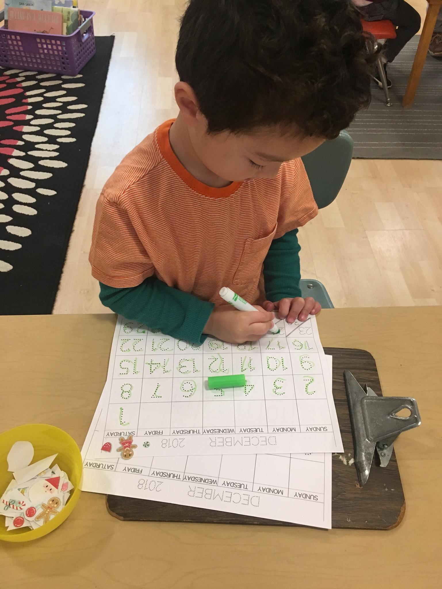 Tyden working on his December calendar