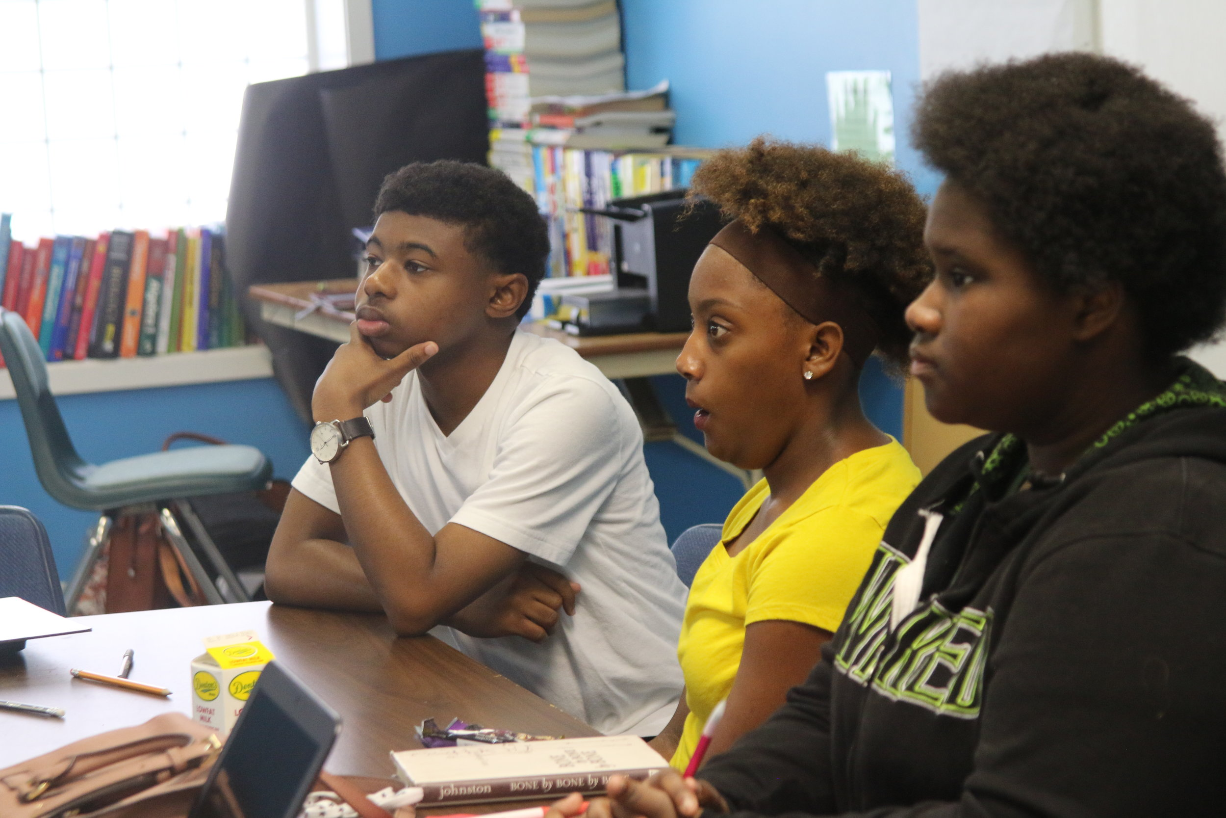 """FSC Students in class, including Ms. Ginn in her """"Wicked"""" hoodie, her favorite play that she got to see in person during Summer Opps last summer."""