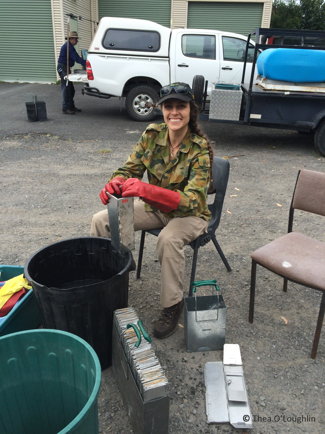 Volunteer Christina cheerfully cleans traps after an intense trapping week