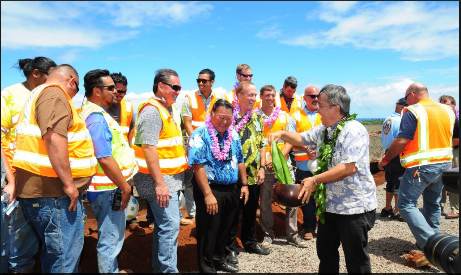 Reverend Alika blesses some of the crew that will be working on the West Maui Hospital and Medical Center project. Mayor and hospital developer (on the right of the mayor) pictured in the middle. Photo: Casey Nishikawa