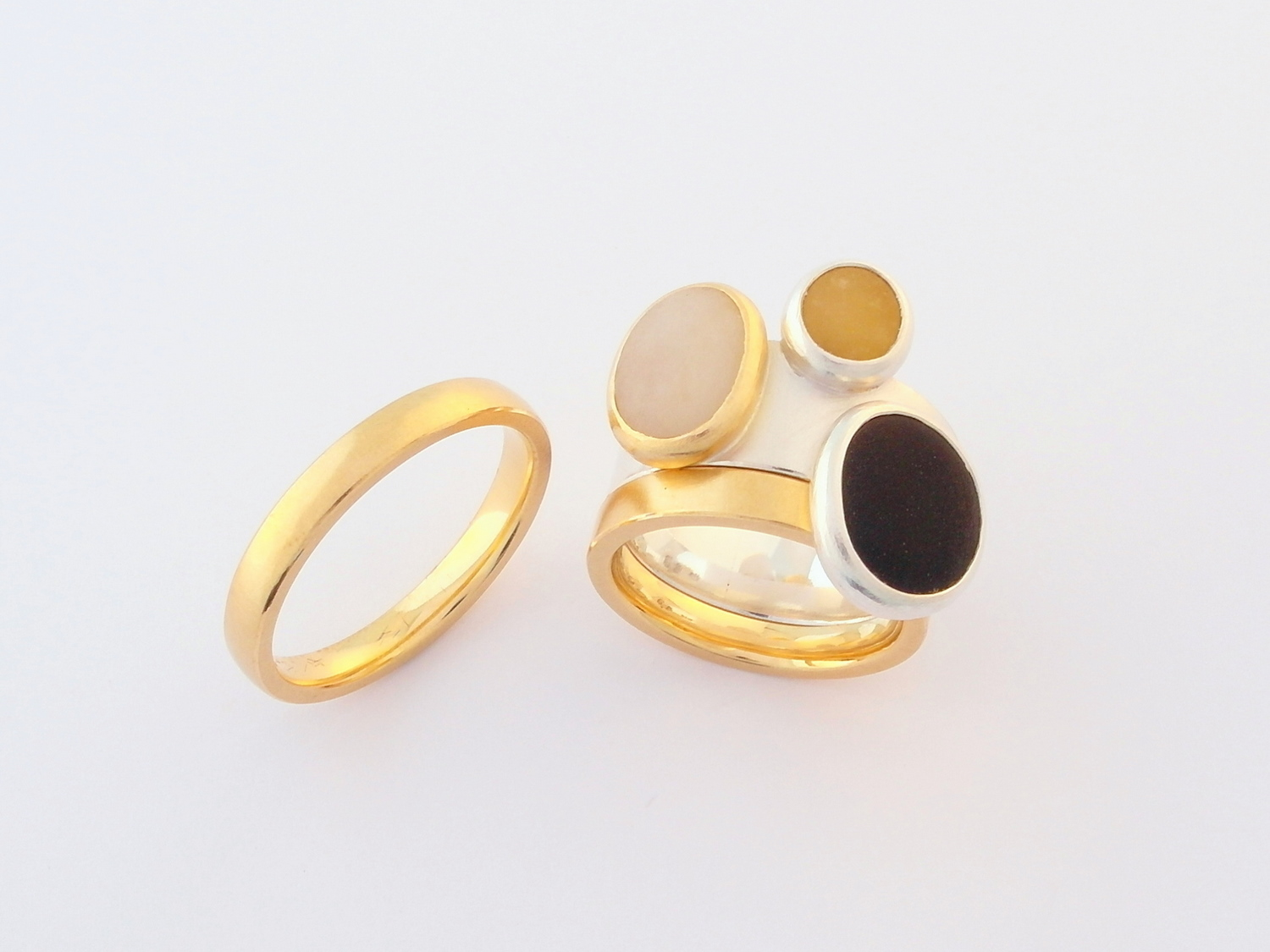 His and hers wedding and engagement rings in 18ct yellow gold and silver set with naturally coloured beach pebbles