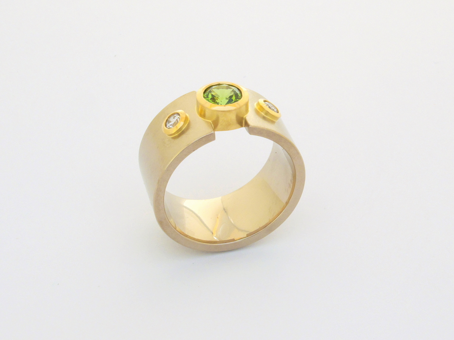 18ct white & yellow gold engagement ring set with clients own diamonds and a tsavorite garnet