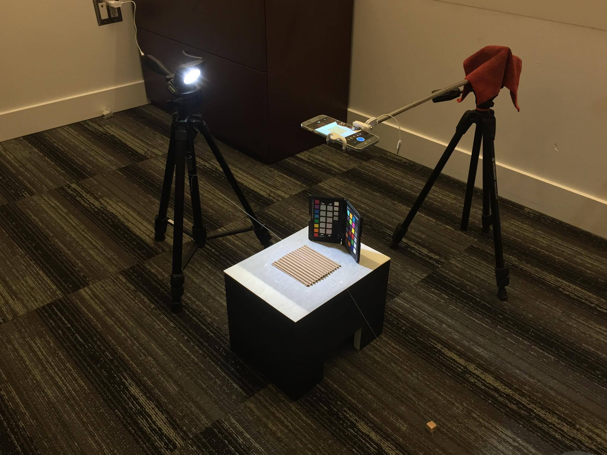 Material Scanning rig (from left to right): Mountable LED light on tripod, Material scanning box (Thanks Ewan!), Material sample, multi angle sheet, tracing paper, x-Rite Colorchecker or Macbeth Chart, Smart Phone capable of capturing DNG in Adobe Lightroom Mobile App, modified selfie stick mounted to another tripod.