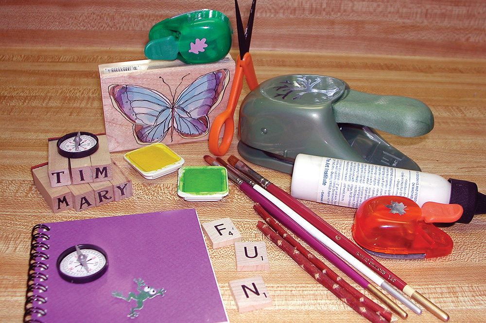 This butterfly journal used a rubber-stamped image that was water-colored. The butterfly was cut out and glued to a measured piece of cardstock. It was then personalized with a rubber stamp alphabet and detailed with a permanent black marker.