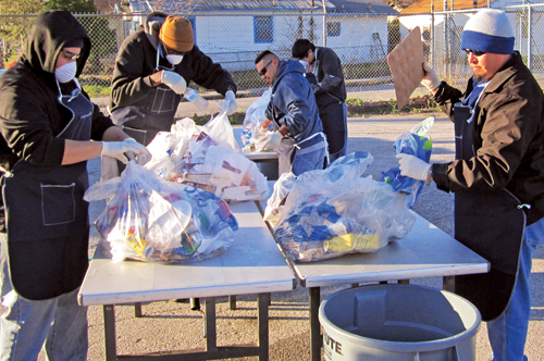 "Workers sort through the trash to make sure the recyclables are ""clean"". Photo Courtesy of San Antonio Parks and Recreation Department"