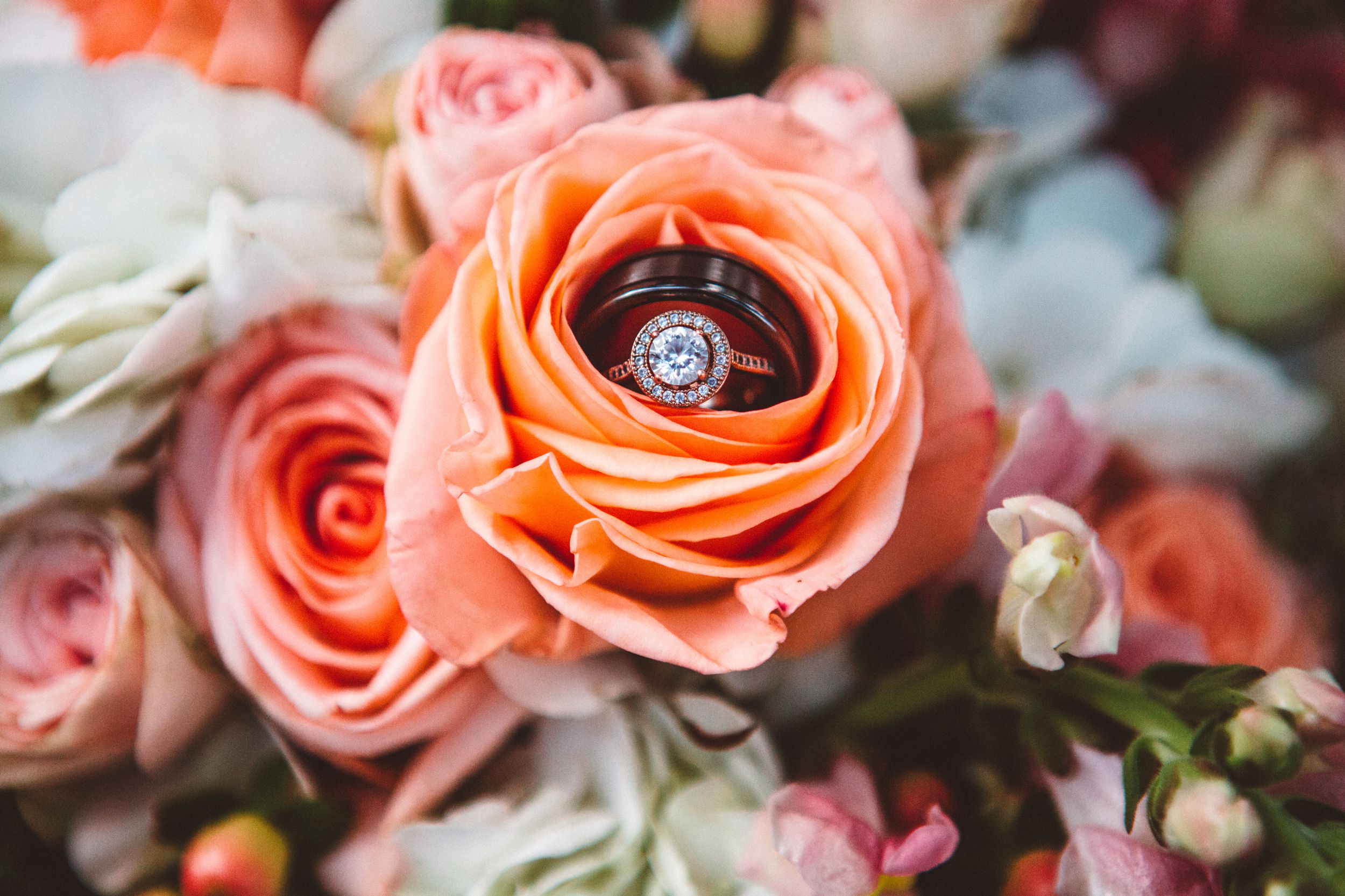 Creative Wedding Ring photo with Coral Organic Rose Bouquet in orlando.jpg