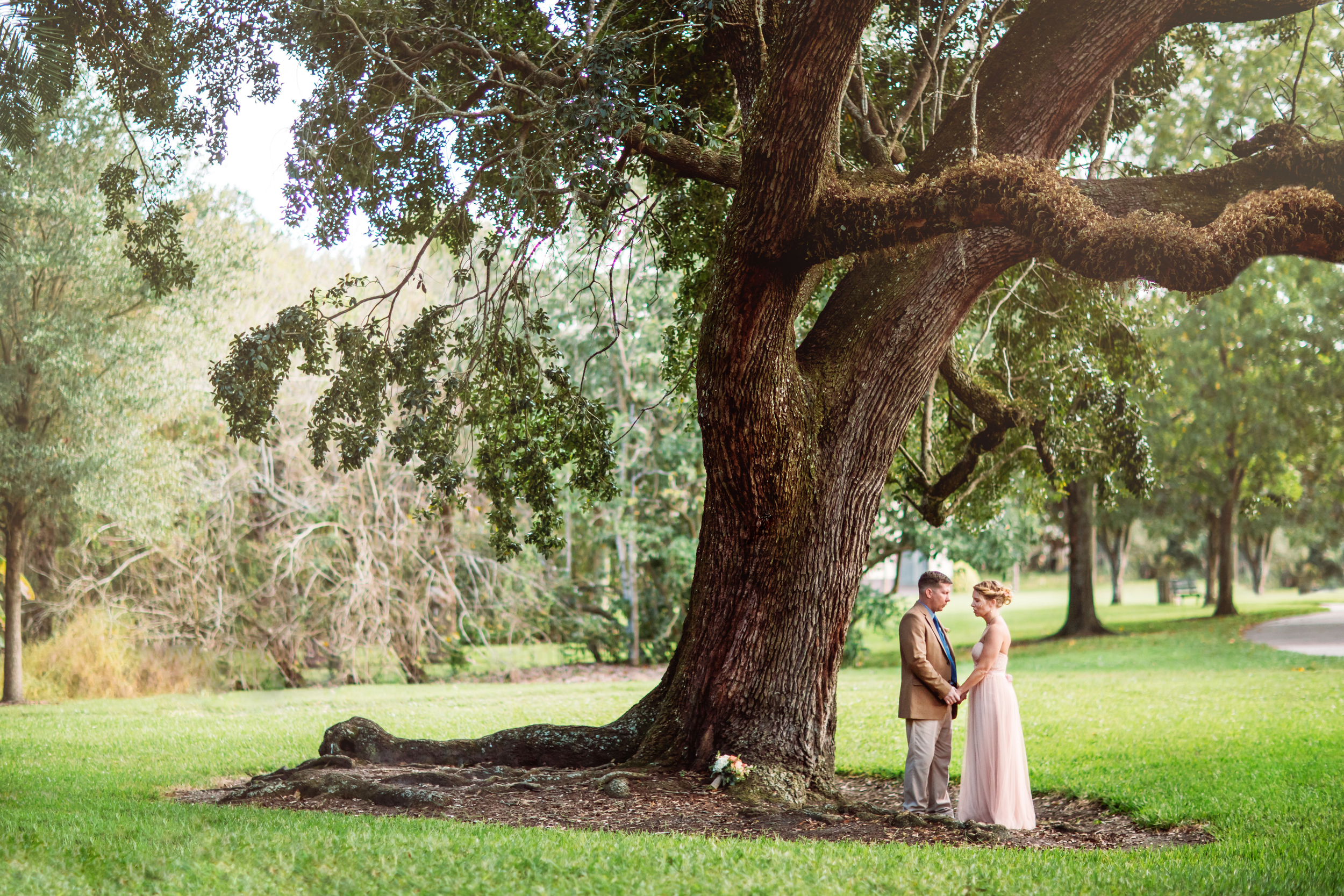 Angie & Joel take a moment to pray together before their ceremony begins underneath one of the beautiful ancient live oak trees in downtown Orlando's Langford Park.
