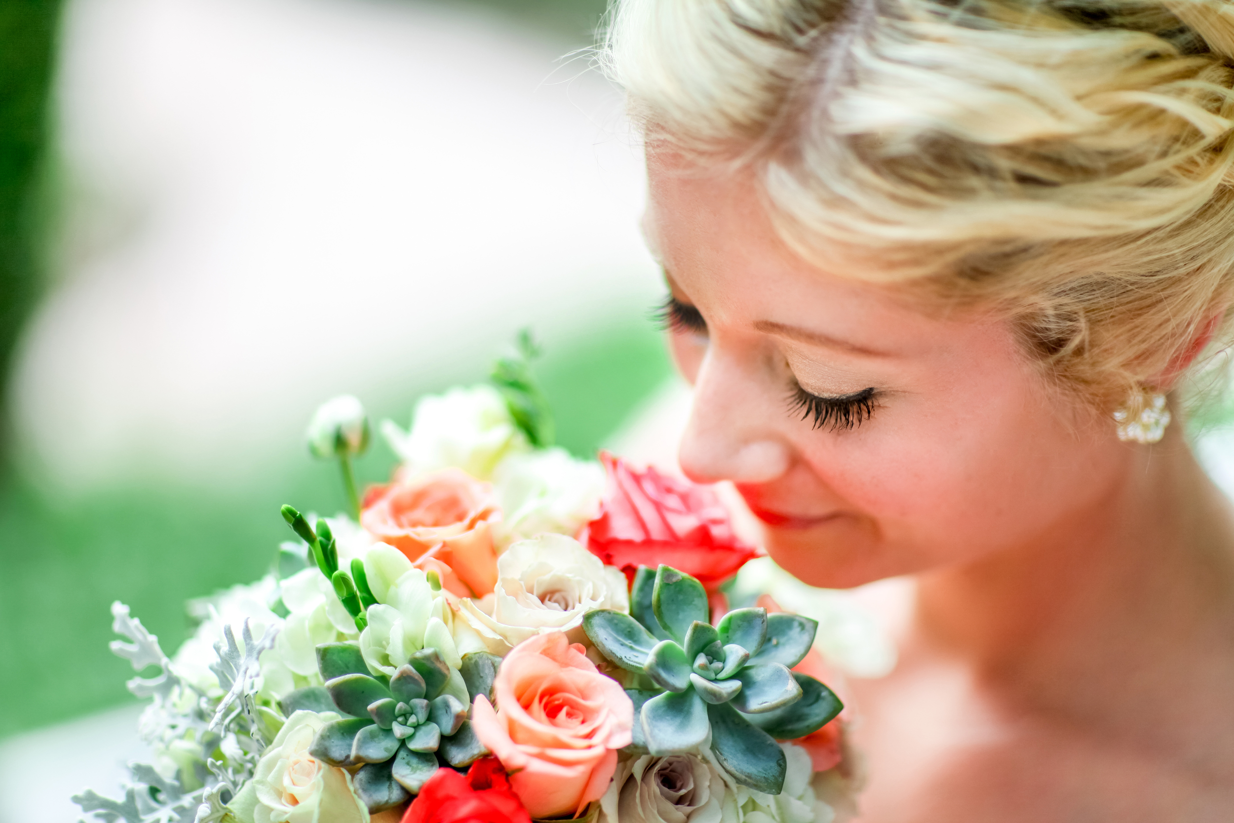 Italian inspired wedding with coral, salmon, white and pink roses, ferns, eucalyptus and dusty miller.