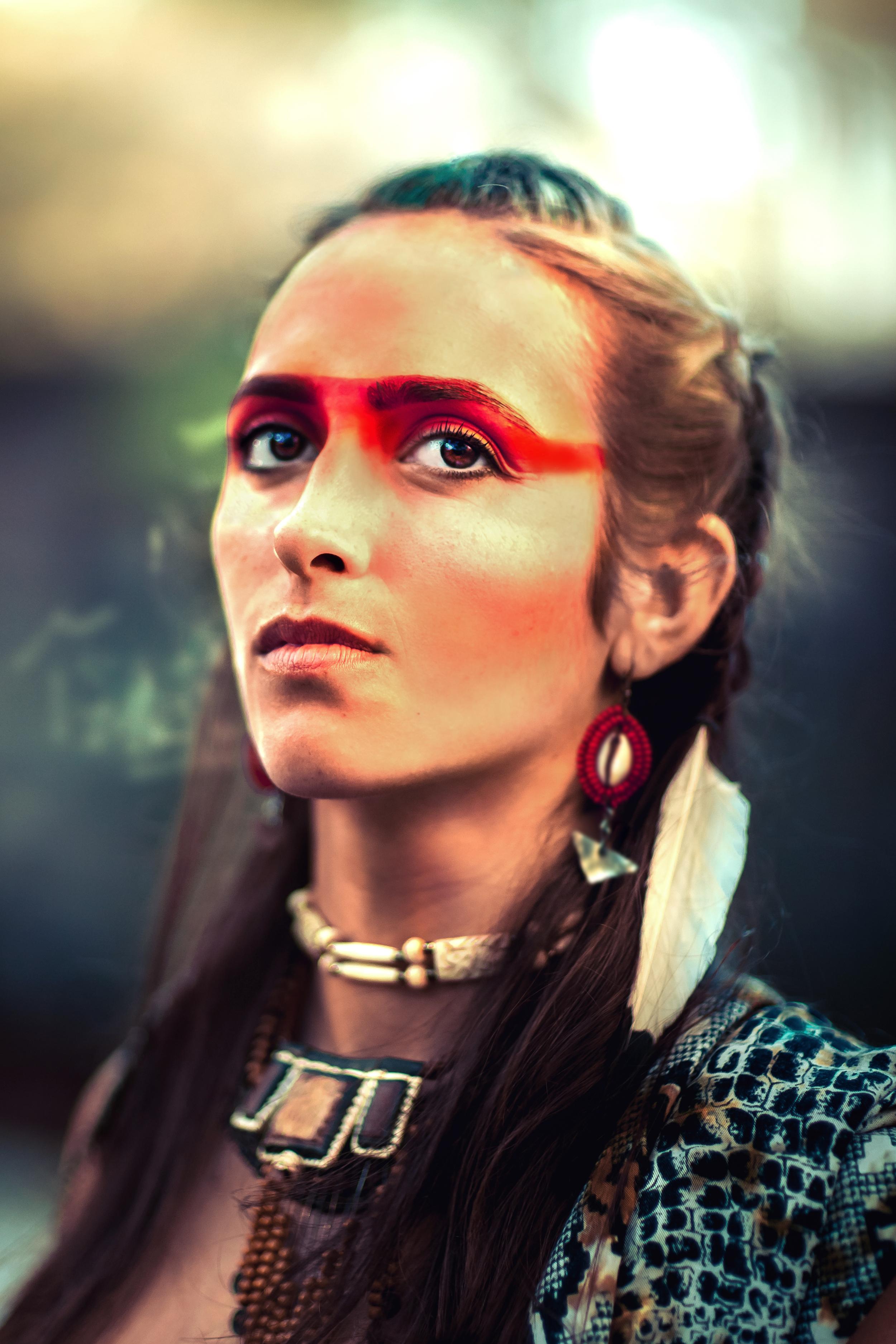 Electric Nomads - feather warrior goddess woman masai mara earrings.jpg
