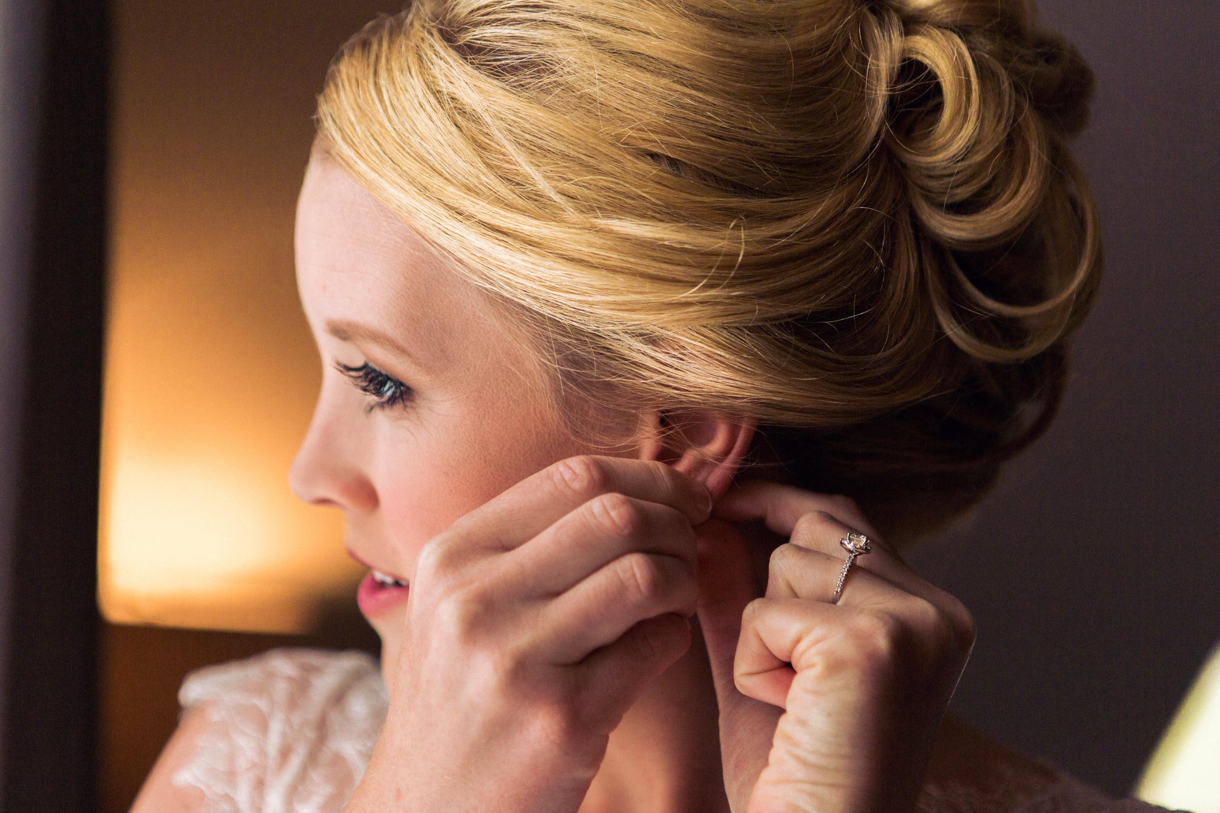 Claire & Sean - Wedding Sneak Peak  bride ring hair earring1.jpg