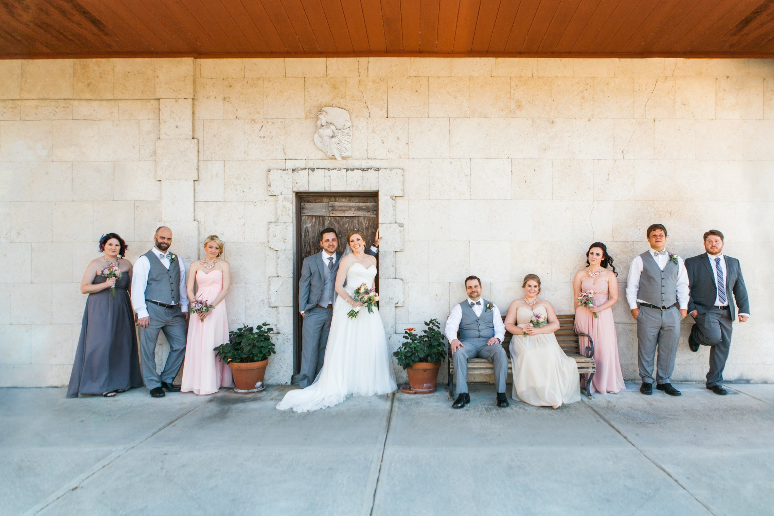 Epic bridal party group photos of groomsmen and bridesmaids in blush lavender gowns in Winter Park Farmers Market Wedding