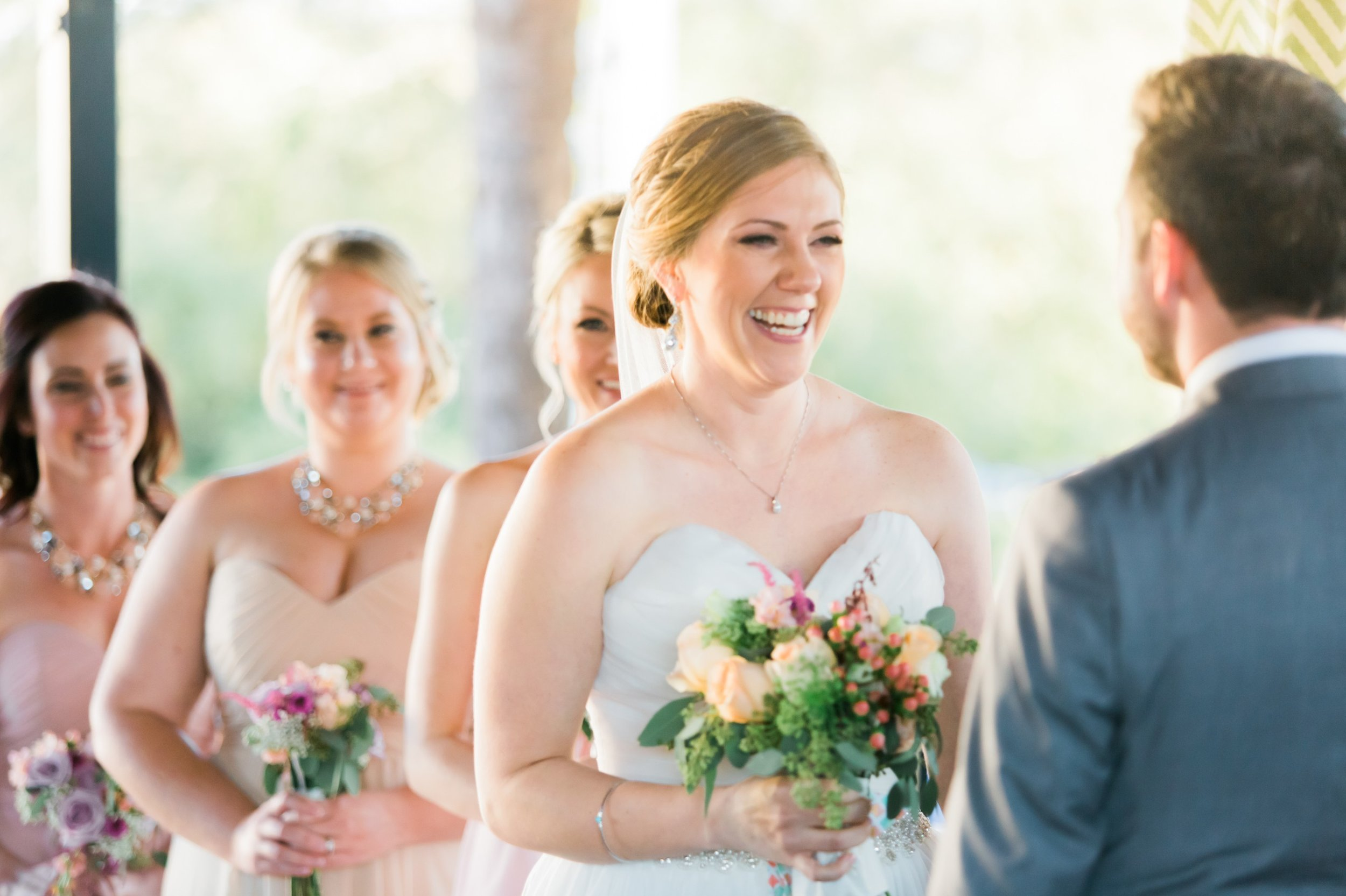 excited bride in strapless sweetheart gown floral bouquet wedding at the Winter Park Farmer's Market