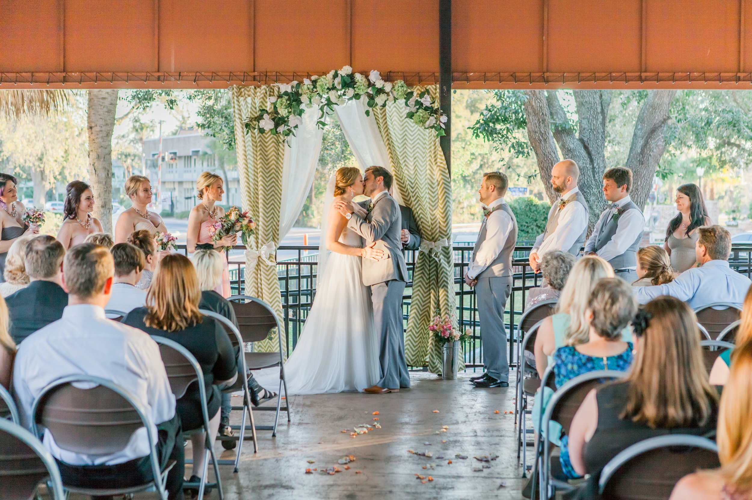 Rustic Chic wedding ceremony first kiss at the Winter Park Farmer's Market
