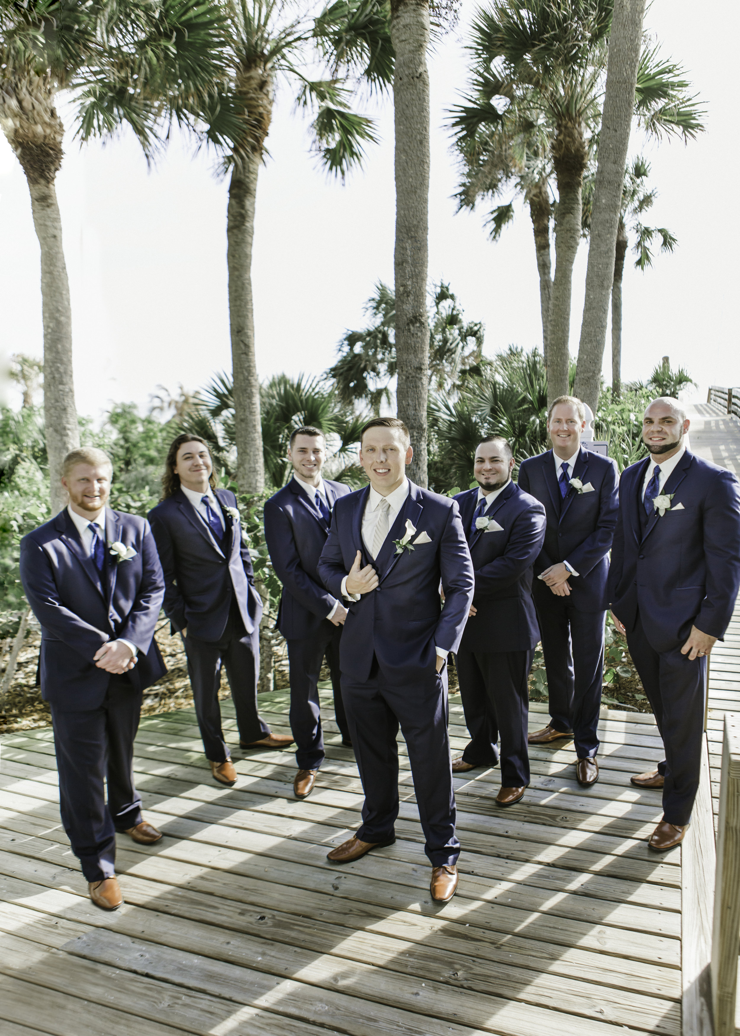 Groom & Groomsmen style with navy tuxedos and brown leather shoes boardwalk