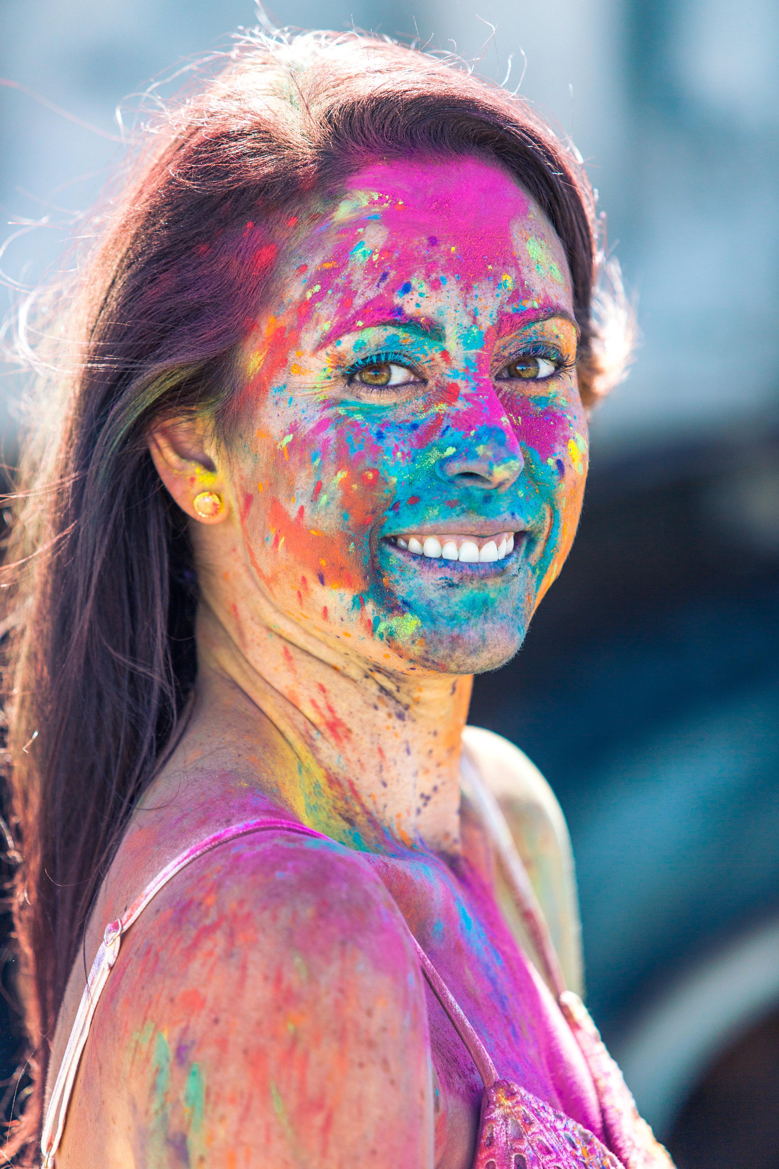 colorful holi powder portrait woman during engagement photos