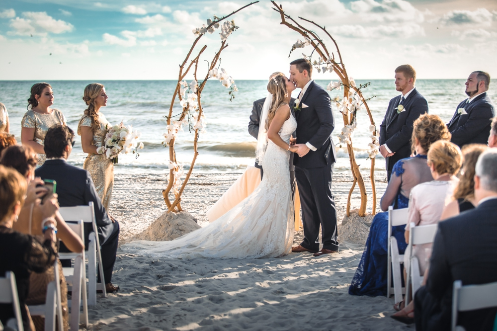 Longboat Key Club Beach Wedding - Ceremony Kiss