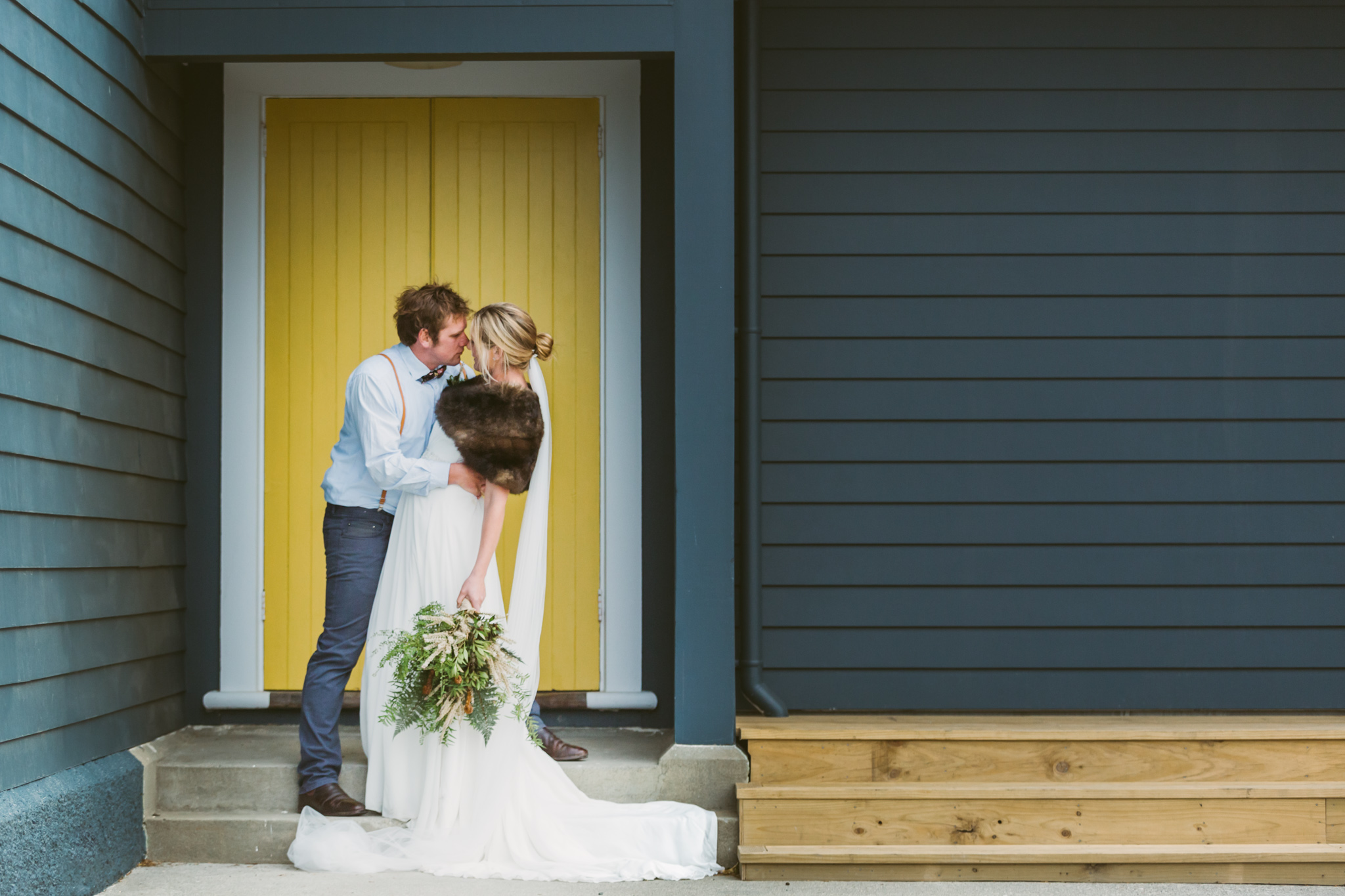 Yellow door at a destination wedding at the Port Molyneux School