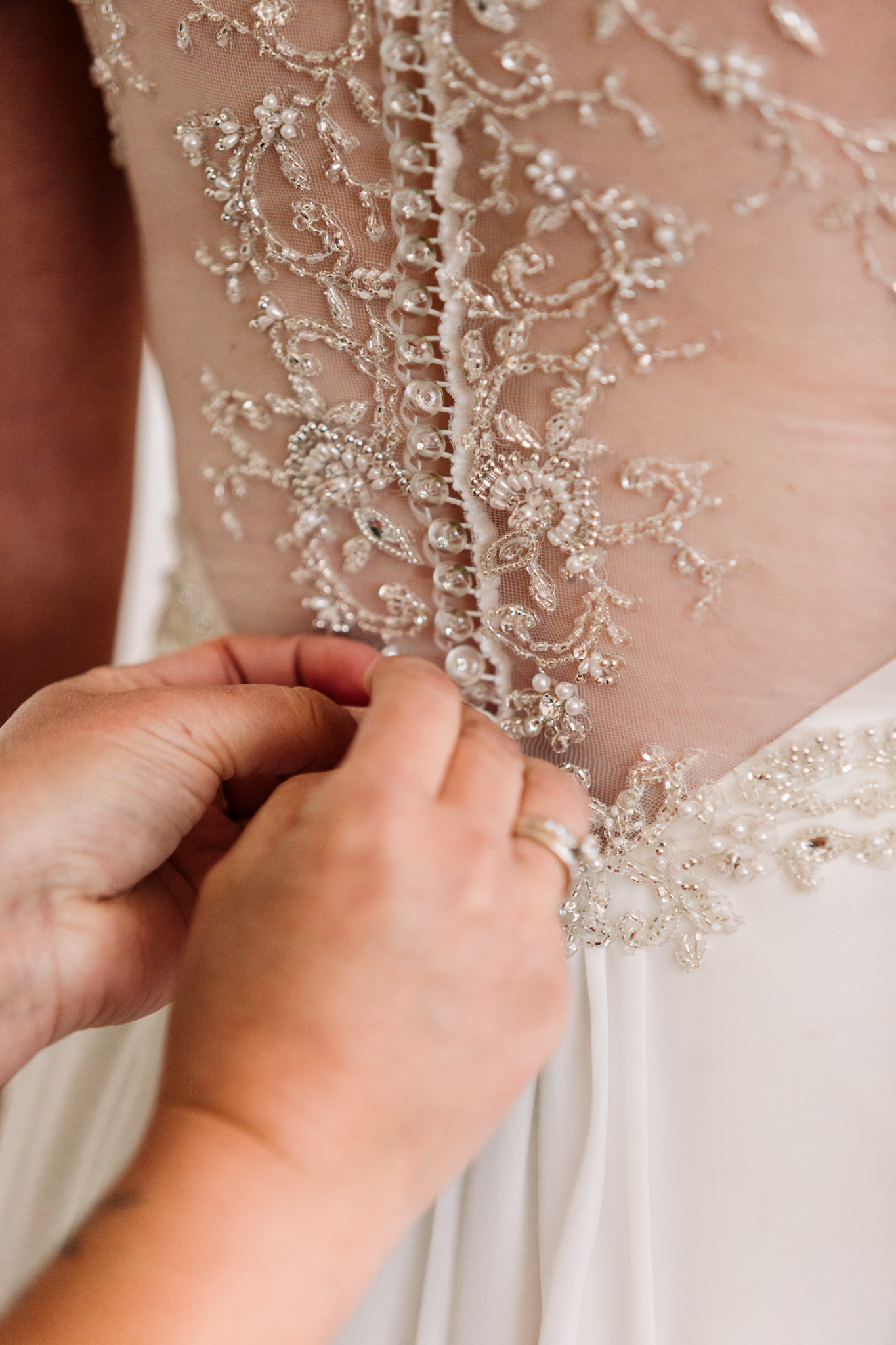 Wedding gown lace details at a destination wedding at the Port Molyneux School