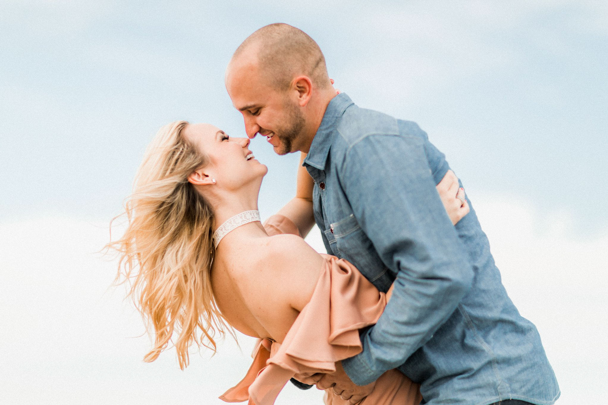 Tommy + Courtney's Cocoa Beach engagement ||Boho surf style engagement outfit inspiration - she wore an apricot maxi dress with a lace choker necklace; he wore a chambray buttondown, dark jeans and brown leather shoes. || Engagement photography by Shaina DeCiryan Lifestyle Wedding Photography || Book your 2017/2018 Wedding at: ShainaDeCiryan.com @shainadeciryan