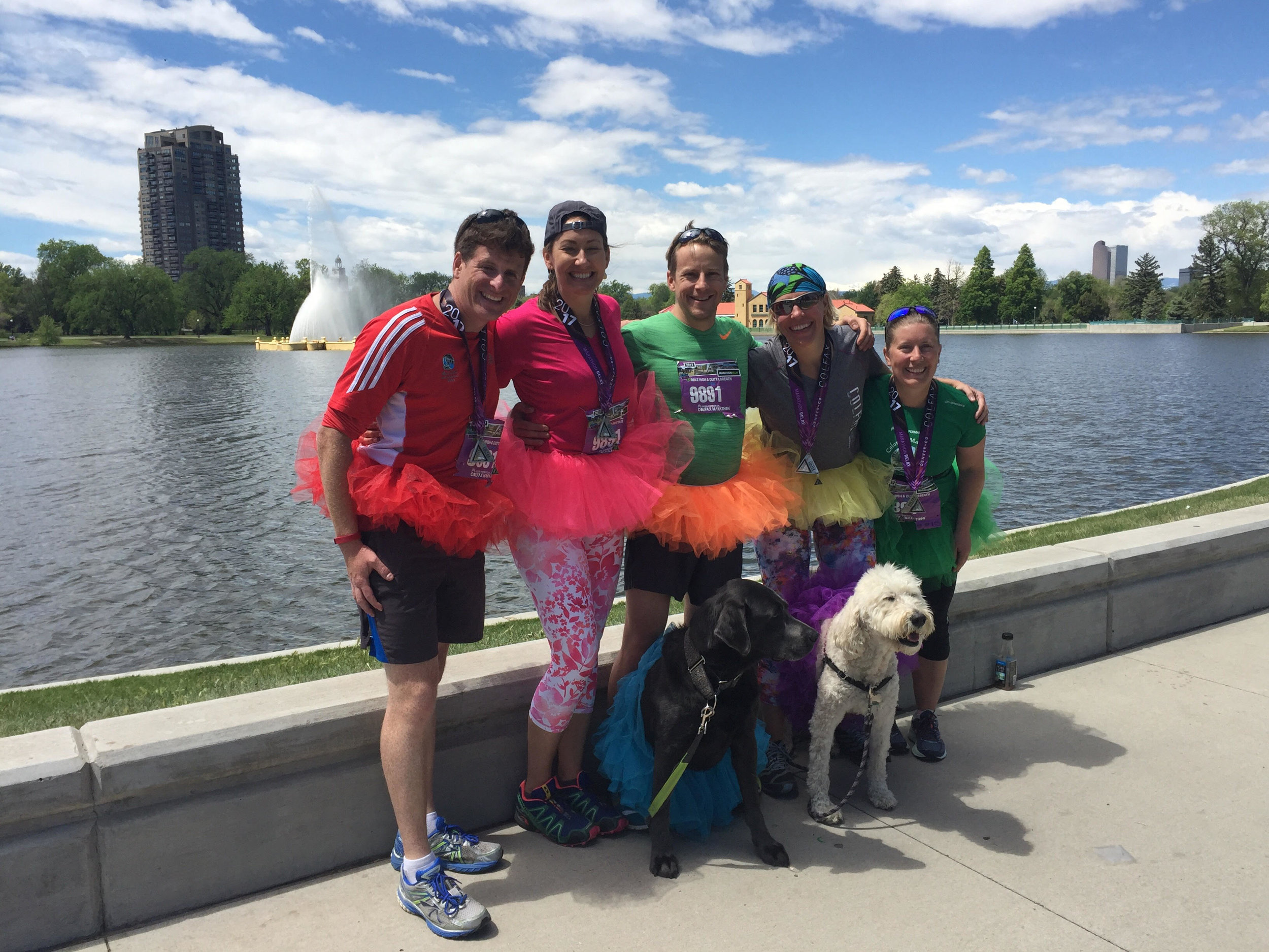 Group shot of the marathon relay team and dogs, all in tutus.