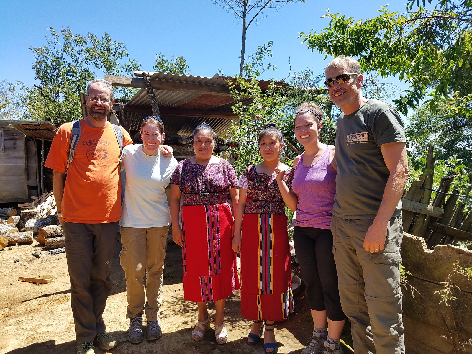 Group photo with two of the gracious community members who made us lunch each day.