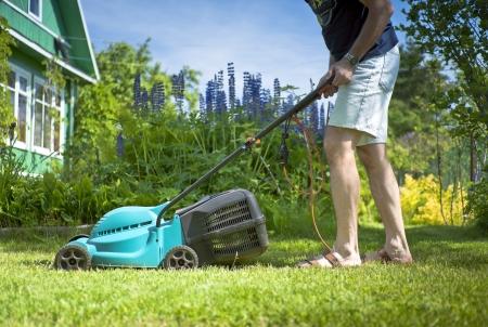 14238529_S_lawn_mow_mower_man_sandal_grass_cutting_walking.jpg