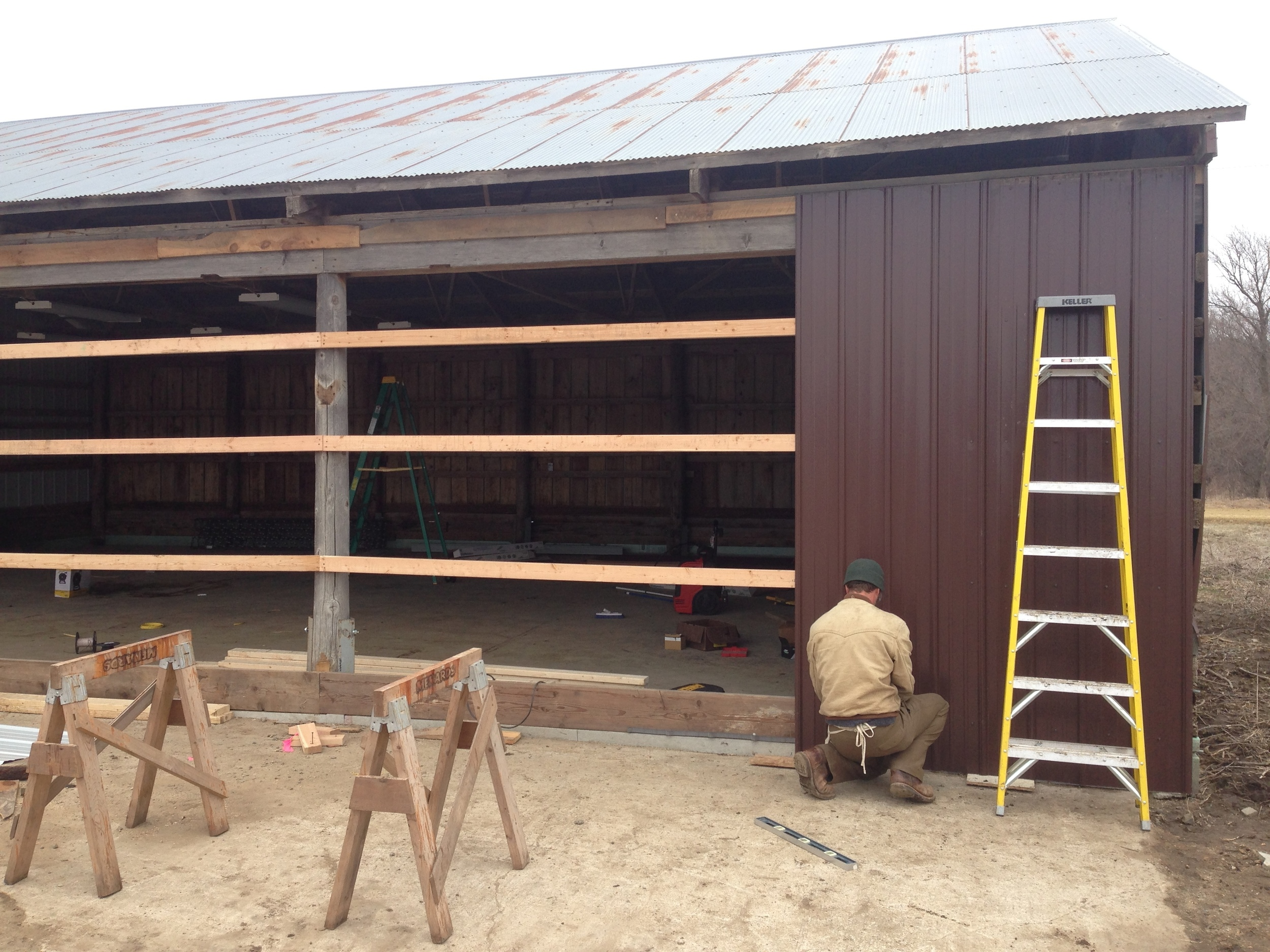 Our first employee, Karl Sames, putting up the siding.