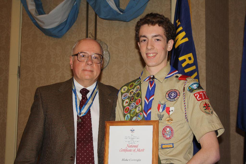 "Director Blake Cortright [R] awarded the BSA National Certificate of Merit for his work on ""The First Encampment."""