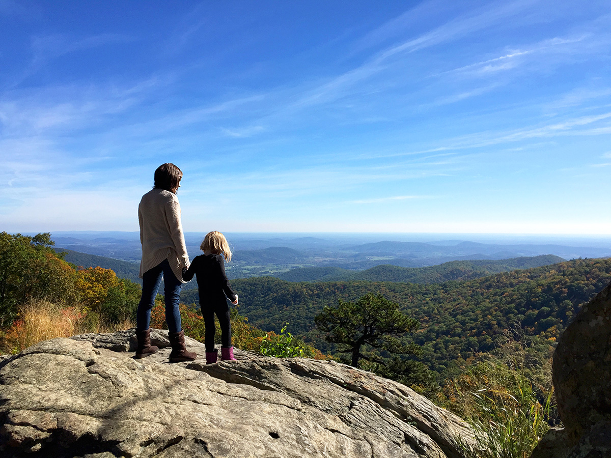 Mother and daughter look out over Shenandoah National Park.