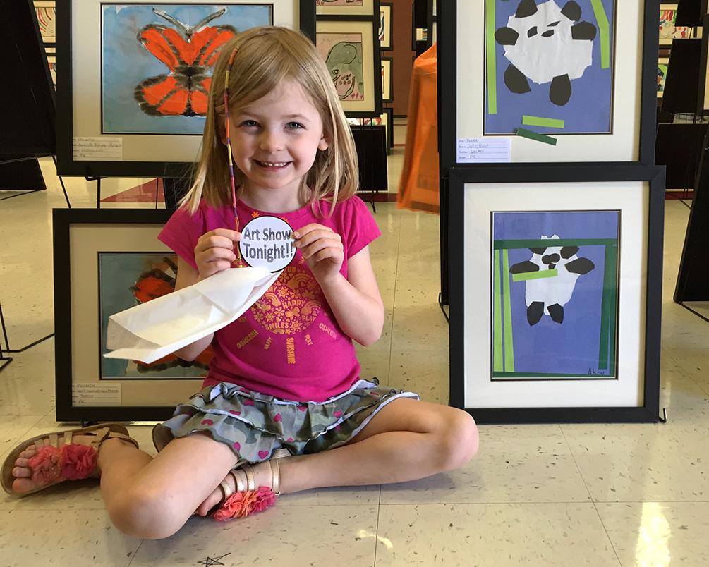 Showing off her artwork.