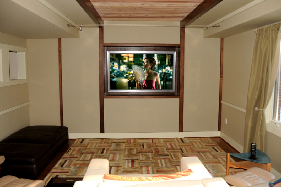 A contemporary and elegant room, this Media room blends seamlessly with the dècor of the home
