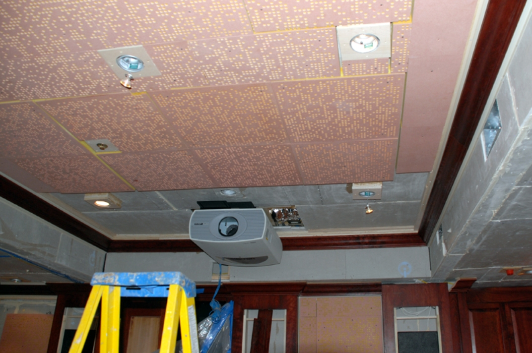 Even the ceiling receives the full acoustic treatment; The projector awaits a custom sound box to eliminate fan noise