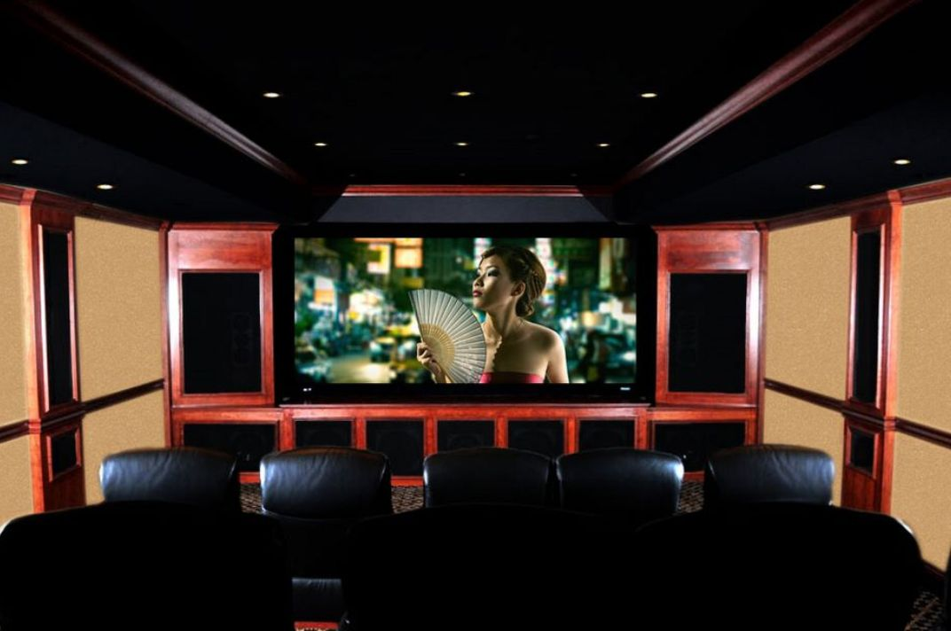 After calibration and adjustment of the audio and video are complete, this finished theater truly represents the pinnacle of home entertainment. Read more about the construction and features on our theater page