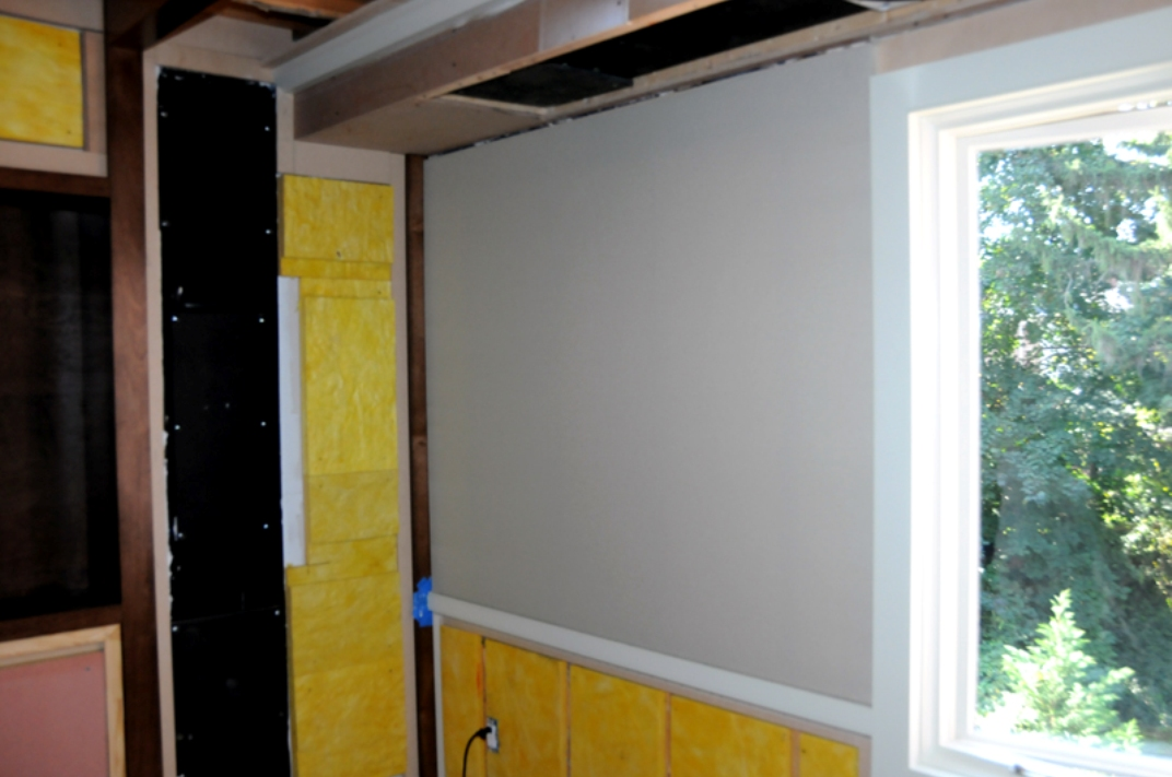 As the fabric begins to go up, solid wall surfaces give shape to the room