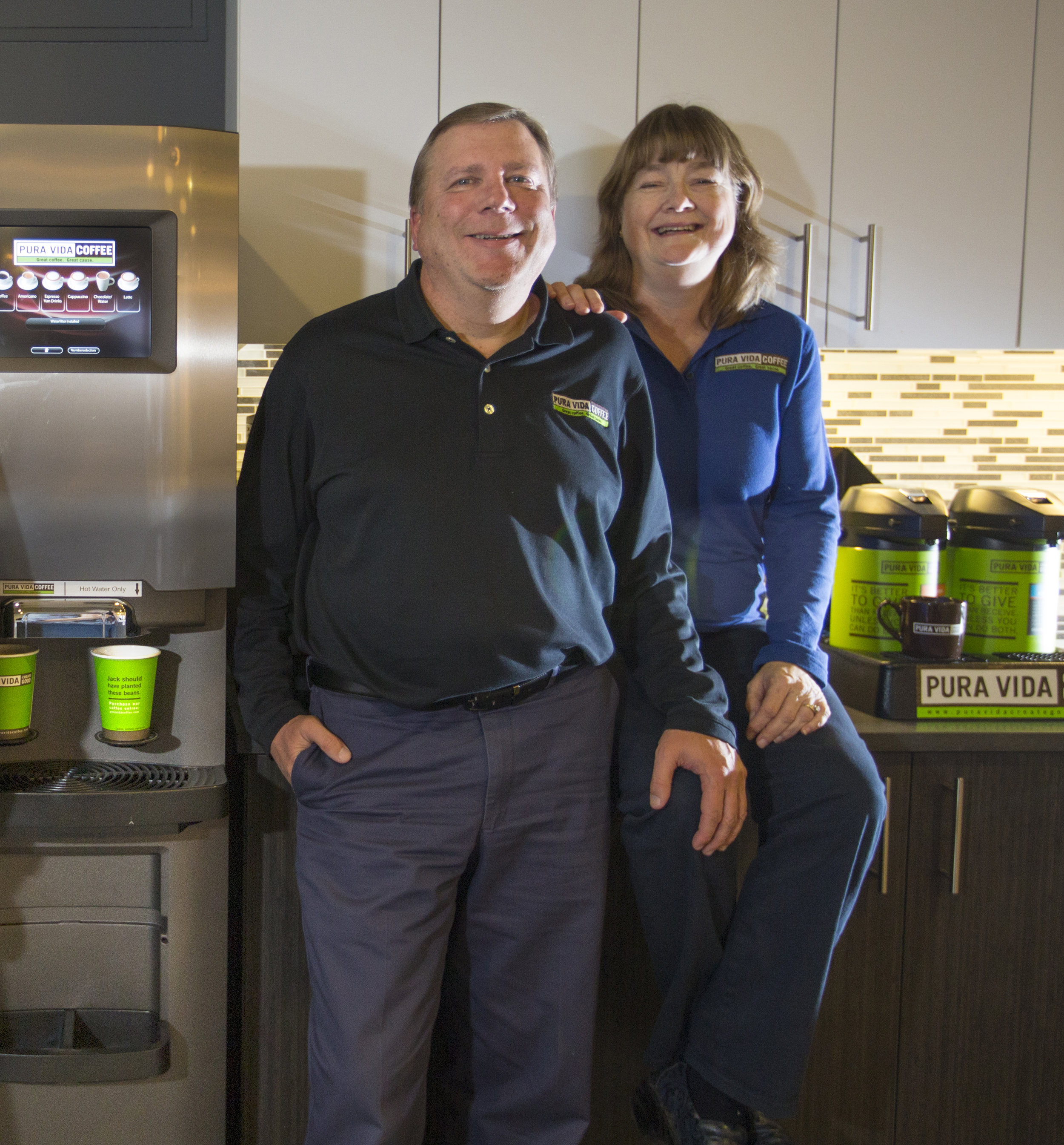 Pictured are a Bean to Cup brewer; and Pura Vida's Ownership Group (left to right) – Jeff and Donna Martin.