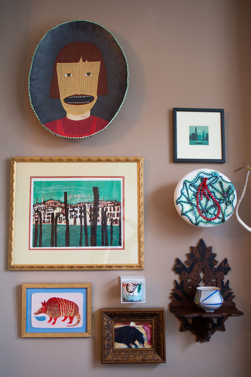 ceramic plate:  Wesley Anderegg ; armadillo painting:  Martha Rich ; ceramic cylinder in Lucite cube:  Lauren Mabry ; ceramic cup:  Peter Pincus