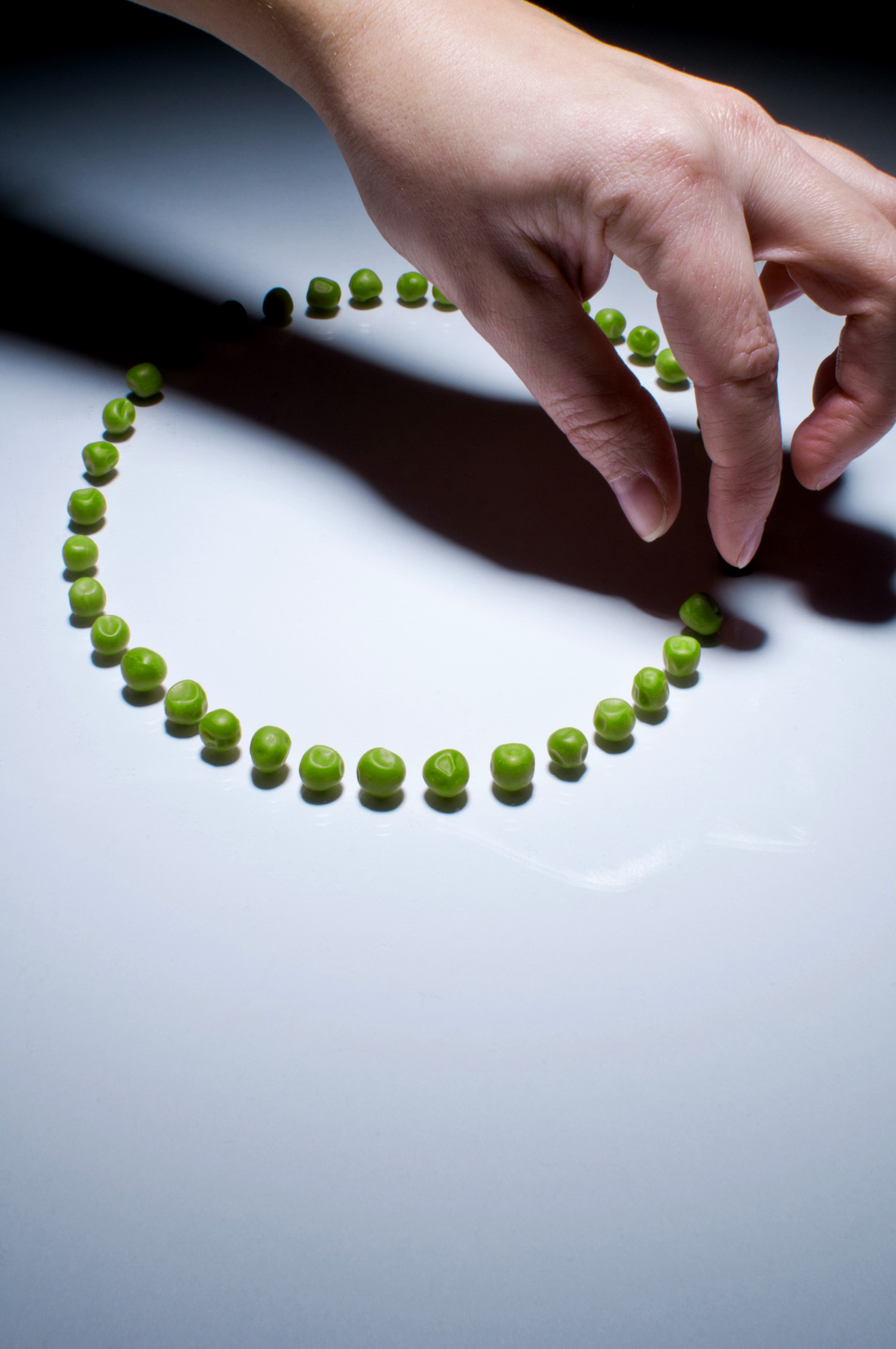 Hand and Peas