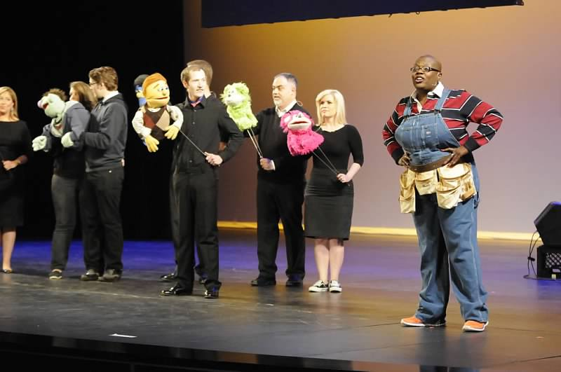 """The cast performs """"It Sucks to Be Me"""" at the award ceremony. Karen Fulks steps in to play Gary Coleman in Bradford Rolen's absence."""