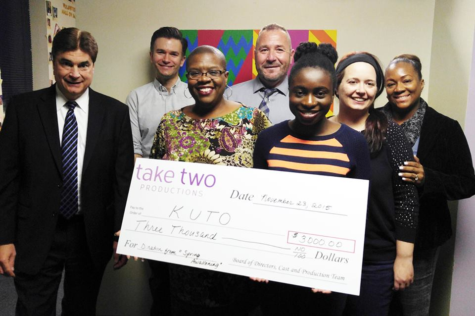 Board members presented a $3,000 check to  KUTO  – a local nonprofit that provides support for teens in crisis – in November 2015 after our production of  Spring Awakening .
