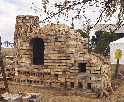 Kiln built by Daniel and helpers at the Gundaroo Woodfire conference, April 2004. The chimney is unfinished at this stage.jpg