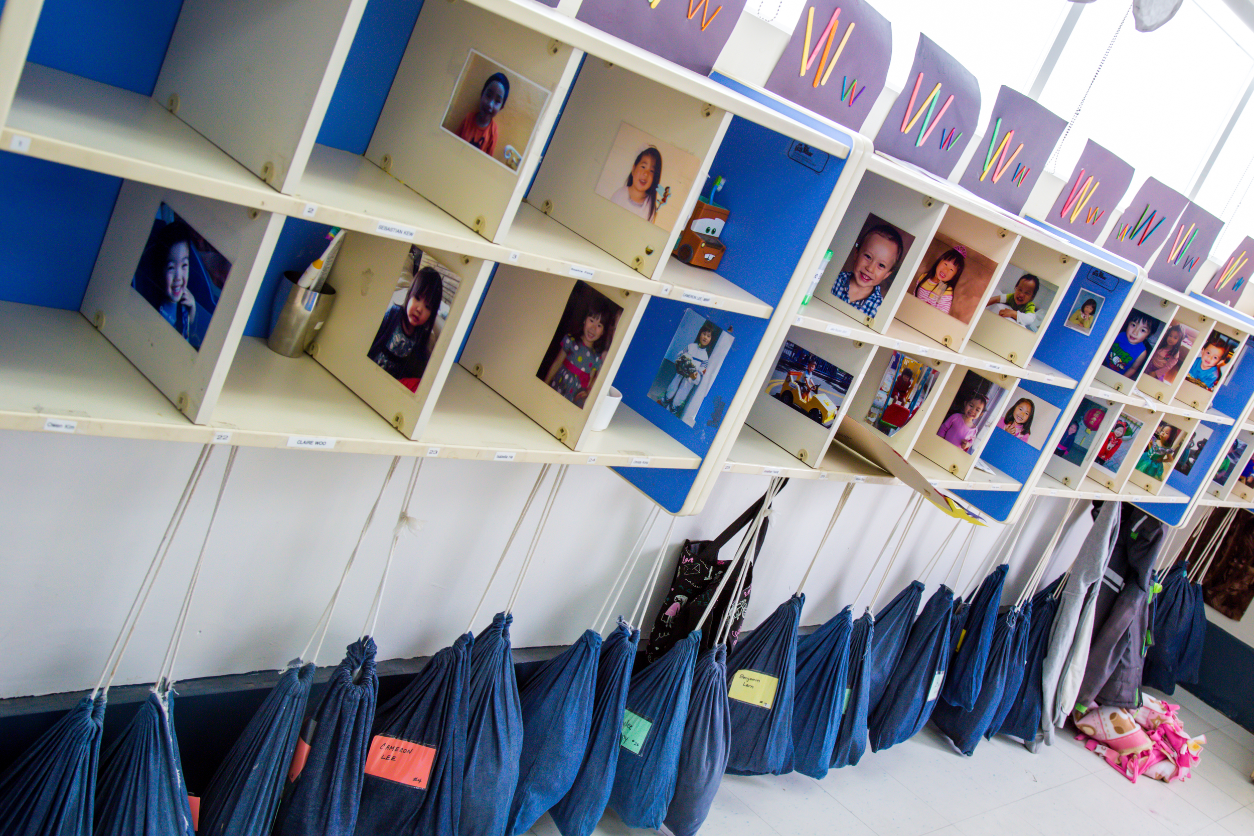 """Daisy Room cubbies & """"blue bags,"""" where children'sspareclothes, emergency snacks, and contact info are kept."""