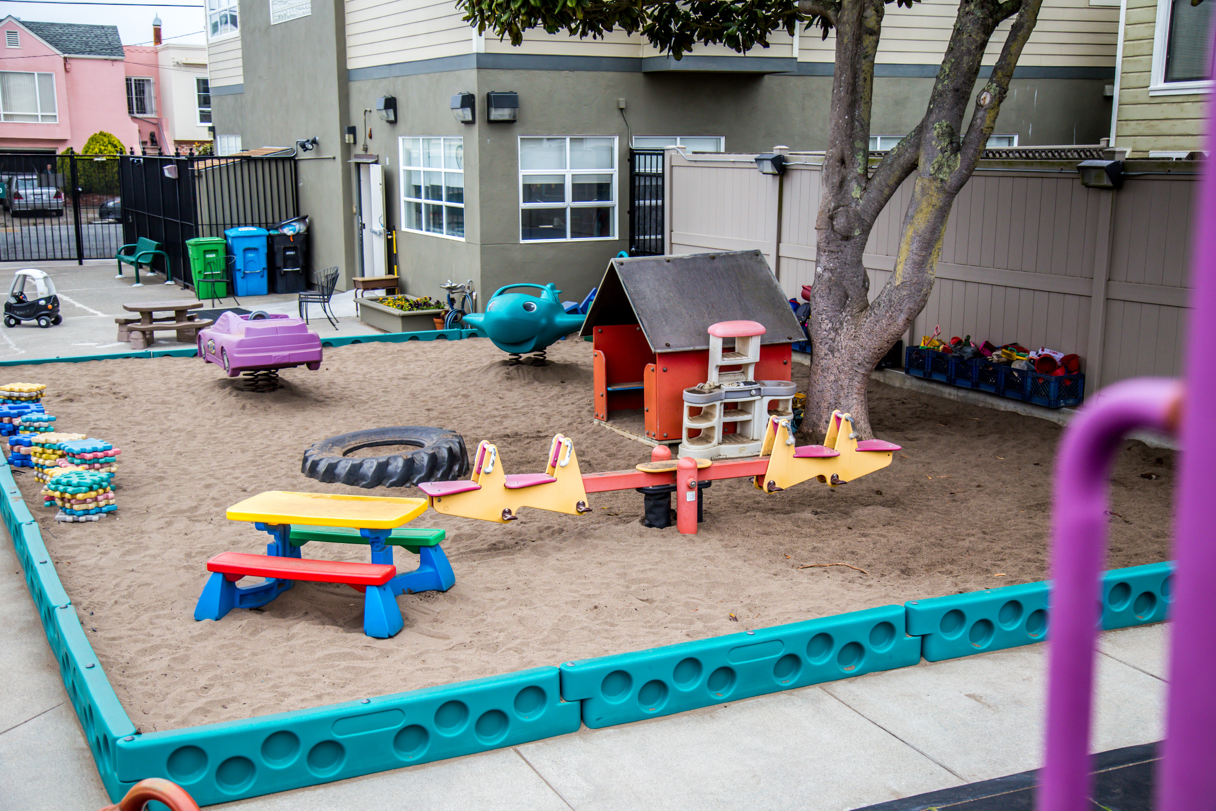 Our sandbox has several permanent structures within it: a small house, and airplane and car to climb in and ride, and a seesaw. From dinosaursto shovels and pails, cups and sieves, tables and blocks, there's something for everyone!
