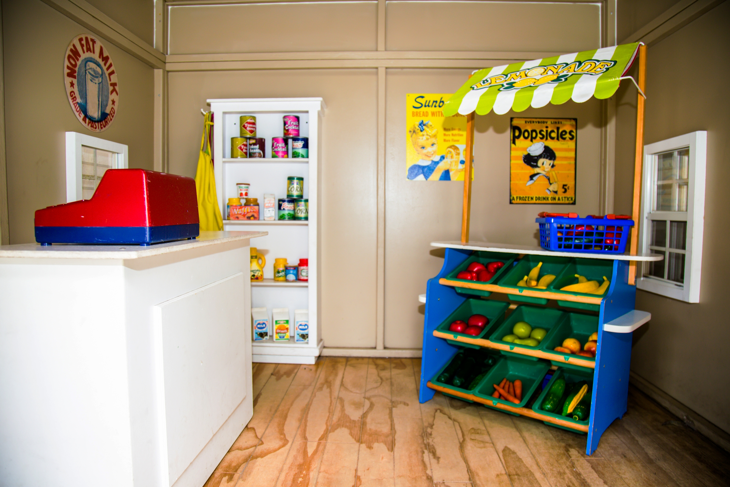 The interior of one of our three child-sized playhouses situated in the yard. We have a market, a fire station, and a cottage that sometimes doubles as a quiet library space!