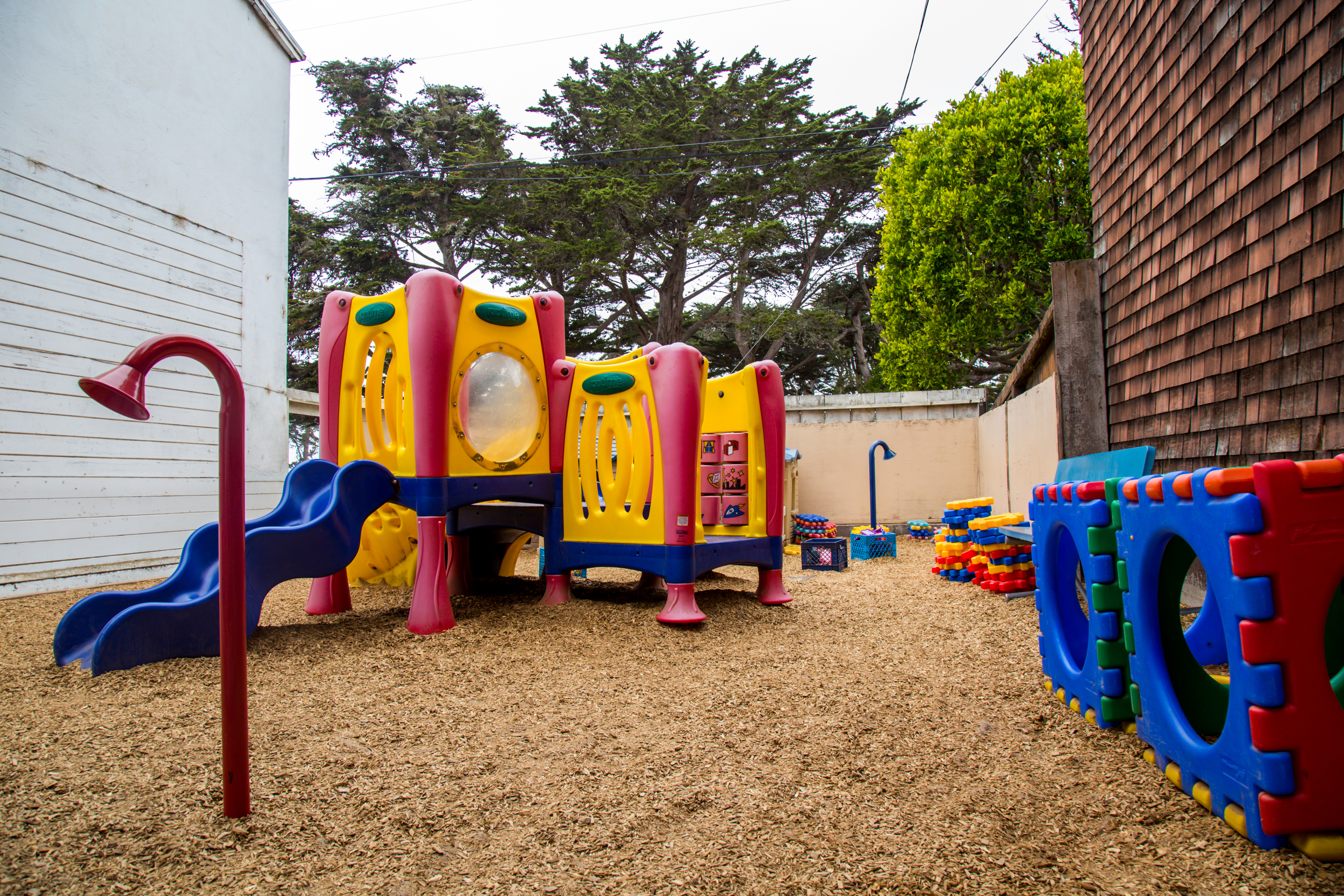 """The yard also features built-in """"telephones"""" for children to communicate to each other across the playground."""