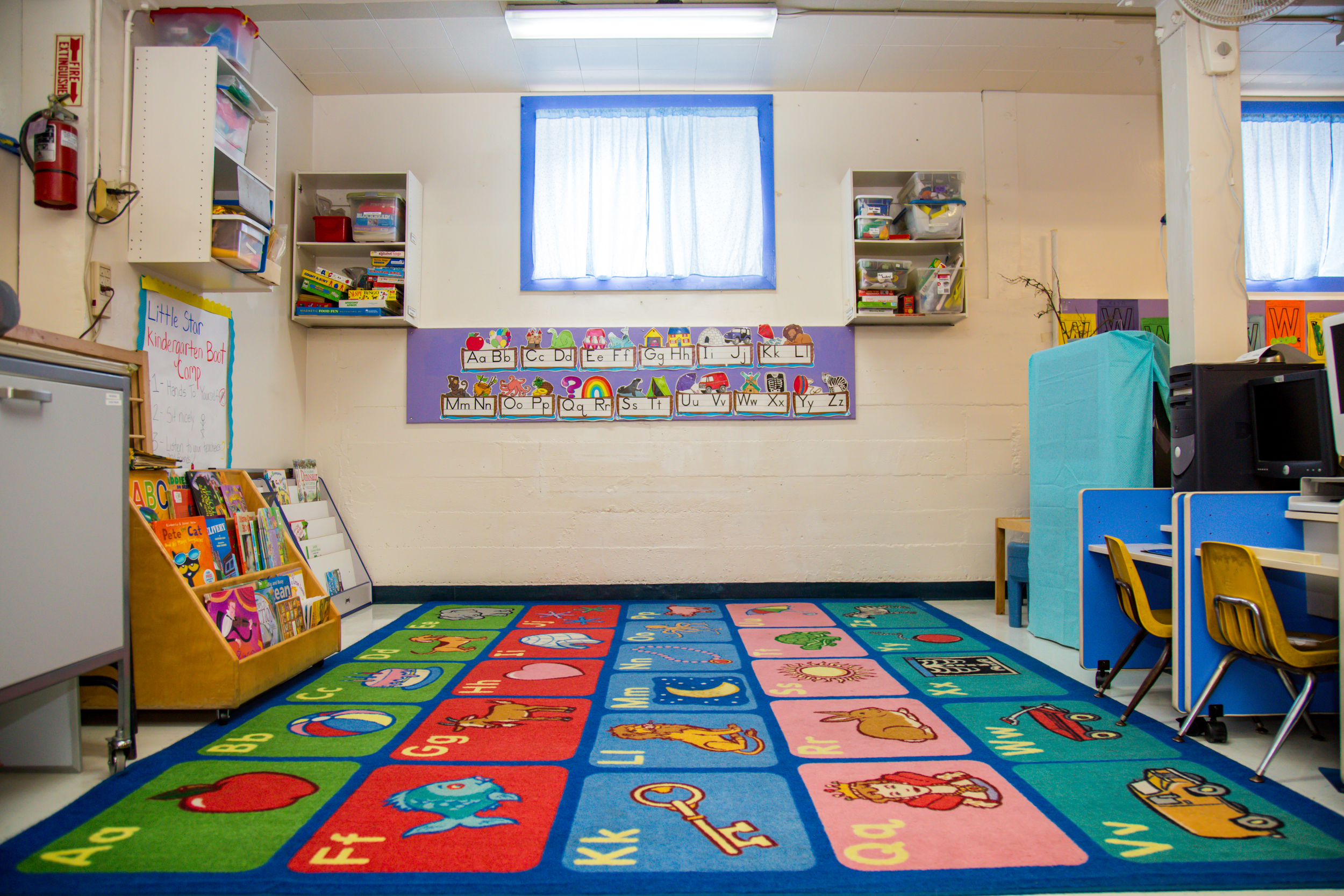 Our library features a rotating selection of books that are always available to children. We havea whiteboard (not pictured) for pre-reading and writing practice in an environment surrounded by the alphabet and stories.