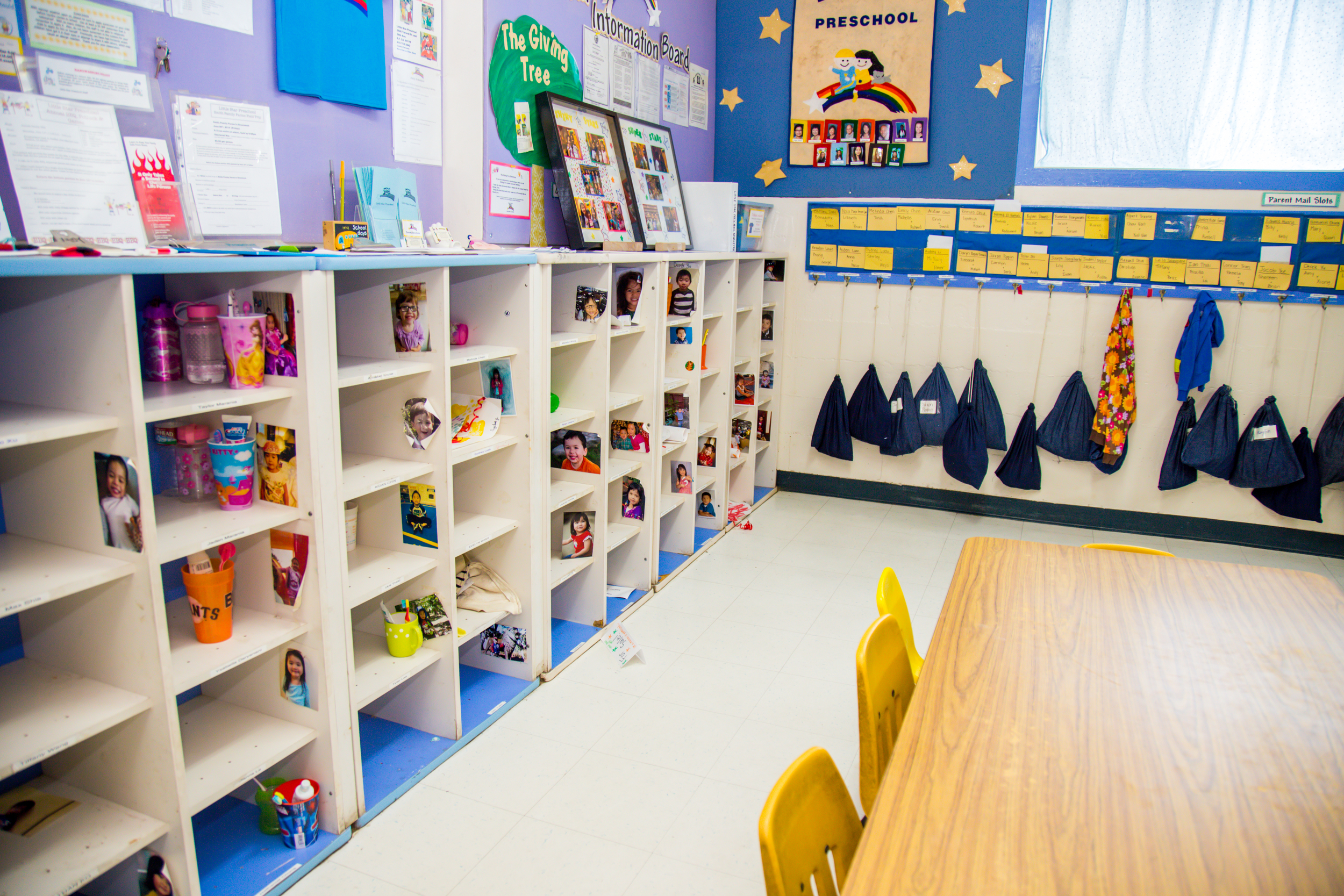 """Each child has his/her own cubby where all artwork, lunchbox, toothbrush, and personal items are stored. In addition, each child has his/her own hook where jackets are hung and a """"blue bag"""" thatstores spare clothes and an emergency snack and info."""
