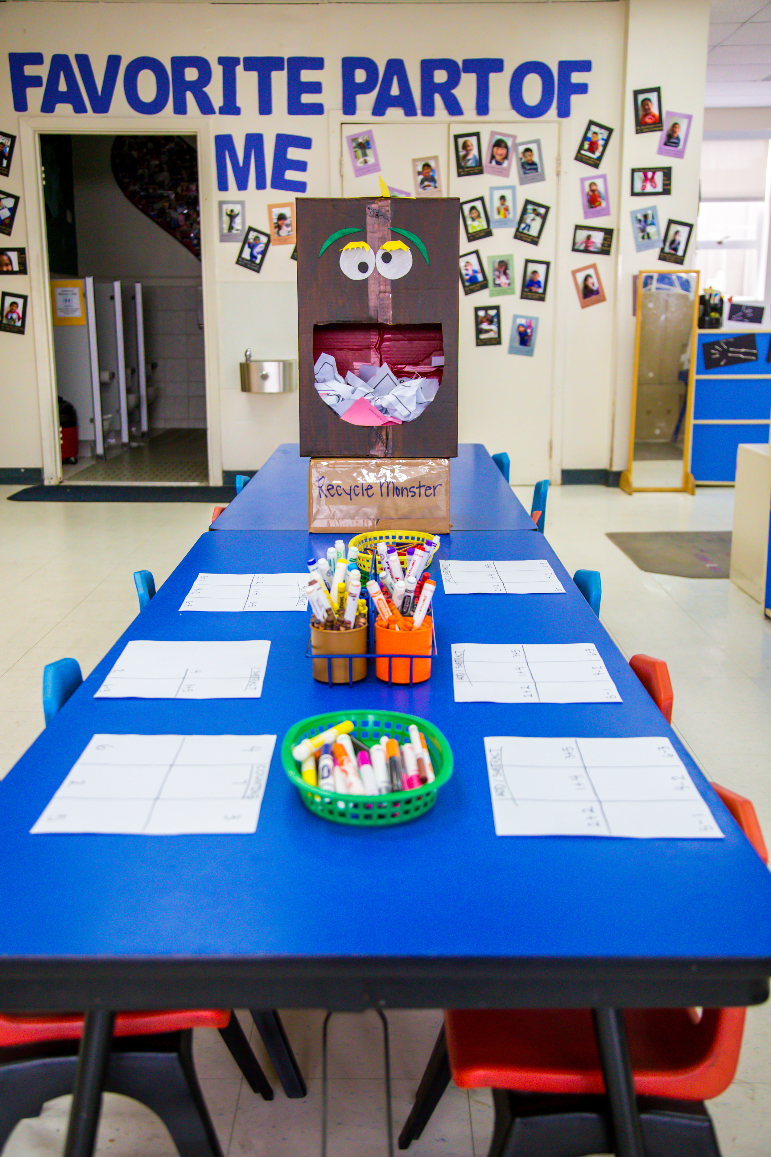 """The Sunflower Room's art center, all set up for morning free play time, complete with a friendly """"Recycle Monster"""" to help us care for bothour classroom and our earth."""
