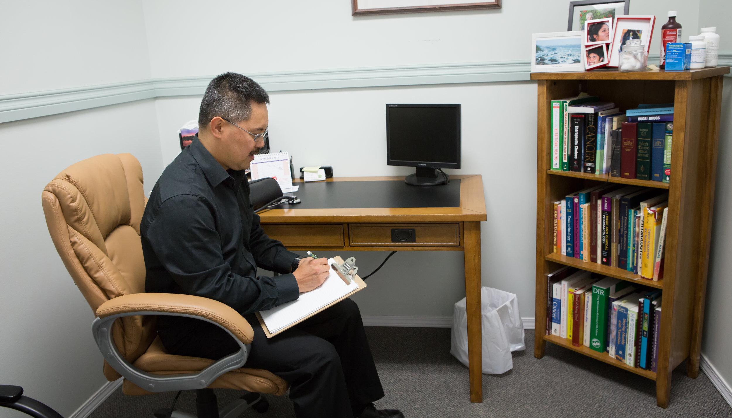 John writing at desk